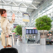 Young woman at the international airport — ストック写真