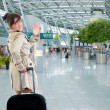 Young woman at the international airport — Stock Photo #5370273