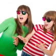 Sisters having fun while watching 3D movie — Stock Photo #5370373