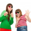 Stock Photo: Sisters having fun while watching 3D movie