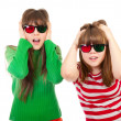 Sisters having fun while watching 3D movie — Stock Photo