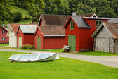 Coloured wooden buildings and the boat — Stock Photo