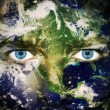 Save the planet - Eyes of Earth - Stock Photo