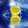 Stock Photo: Lemon splashing in water