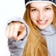 Beautiful young woman pointing towards viewer — Stock Photo