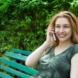Beautiful young woman talking at the phone — Stock Photo