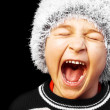 Portrait of a young boy screaming - Stock Photo