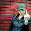Stock Photo: Young woman showing middle finger