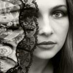 Beautiful woman hiding behind fan — Stock Photo