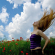 Girl with beautiful hair in splendid green meadow — Stock Photo