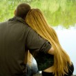 Lovers on lakeside — Stock Photo