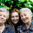 Young woman with two senior ladies — Stock Photo