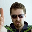 Trendy guy showing ok sign — Stock Photo