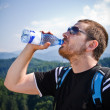Stock Photo: Handsome mdrinking water
