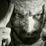 Upset man with cracked skin — Stock Photo #4943109