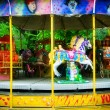 Carousel in themepark — Stock Photo