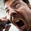 Man shouting at telephone — Stock Photo