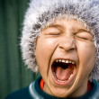Stock Photo: Crazy kid screaming loudly
