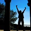 Man silhouette expressing victory — Stock Photo