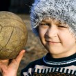 Stock Photo: Needy boy with warn ball in his hand
