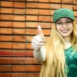 Smiling blonde showing thumbs up — Stock Photo