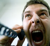 Angry stressed businessman at the phone — Stock Photo