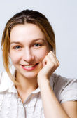 Cute young woman smiling — Stock Photo