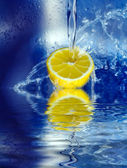 Lemon splashing in water — Stock Photo