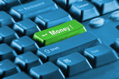 Green money button on a blue keyboard — Stock Photo