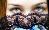Mysterious woman with intense green eyes — Stock Photo