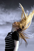 Sexy young woman with hair in the air — Stock Photo