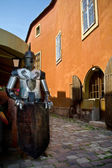 Armoured knight holding a blank shield — Stock Photo