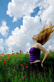 Girl with beautiful hair in splendid green meadow — Stock Photo
