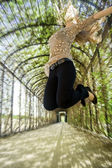 Victorious young woman jumping — Stock Photo