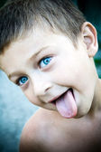 Cute kid sticking his tongue out — Stock Photo