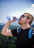 Handsome man drinking water — Stock Photo