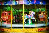 Carousel in themepark — Stock Photo