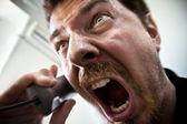 Man shouting at telephone — Stock Photo
