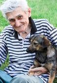 Happy senior with his best pal — Stock Photo