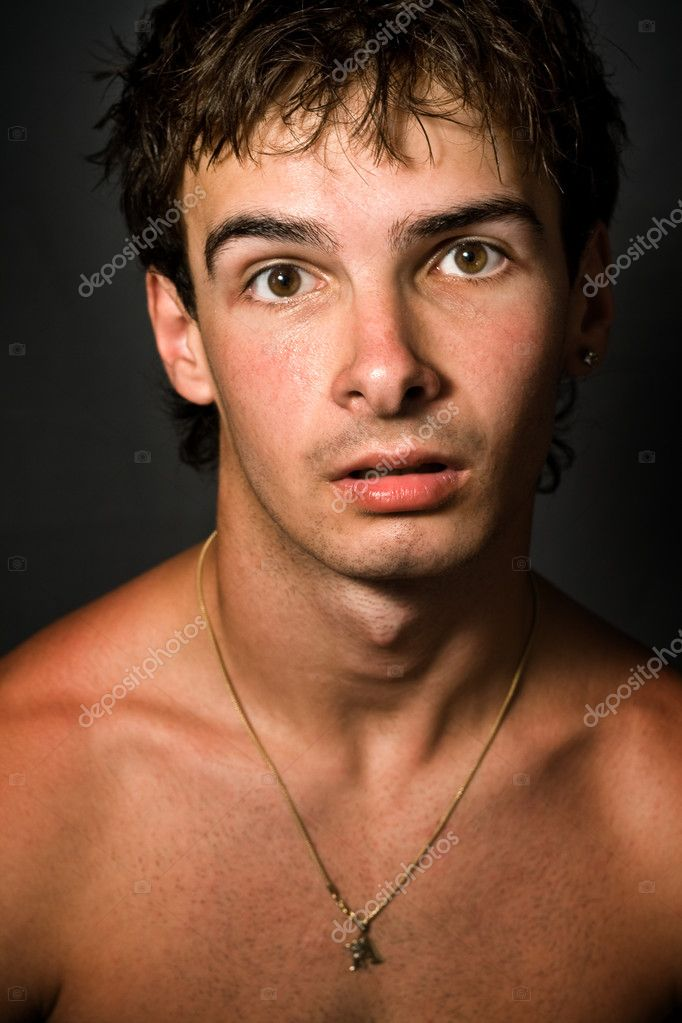 Portrait of young man with funny surprised expression on his face  Stock Photo #4941881