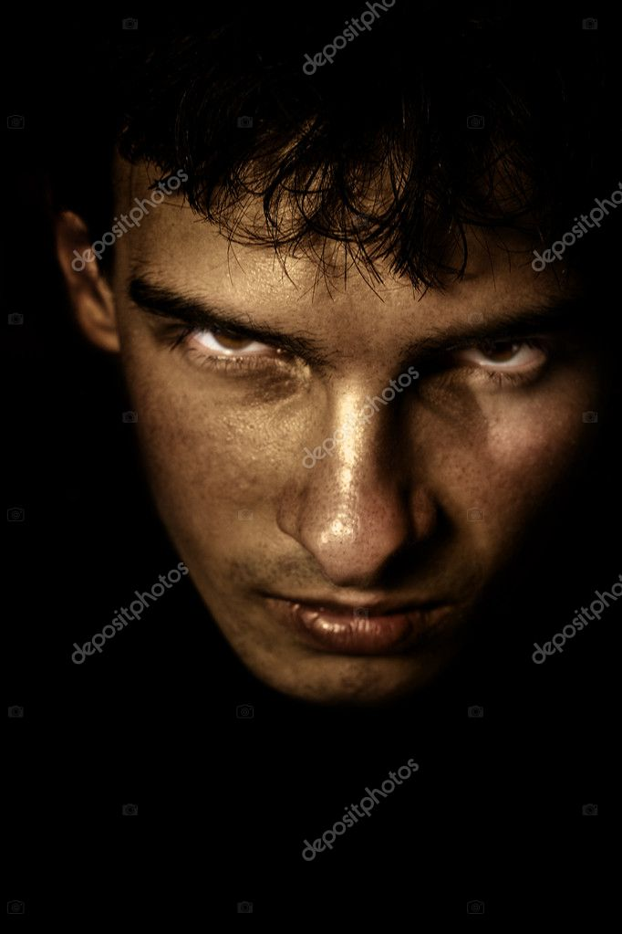 Low key portrait of evil looking man — Stock Photo #4941951