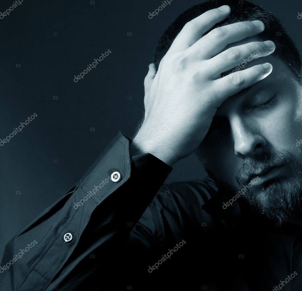 Low key portrait of depressed businessman  Stock Photo #4942003