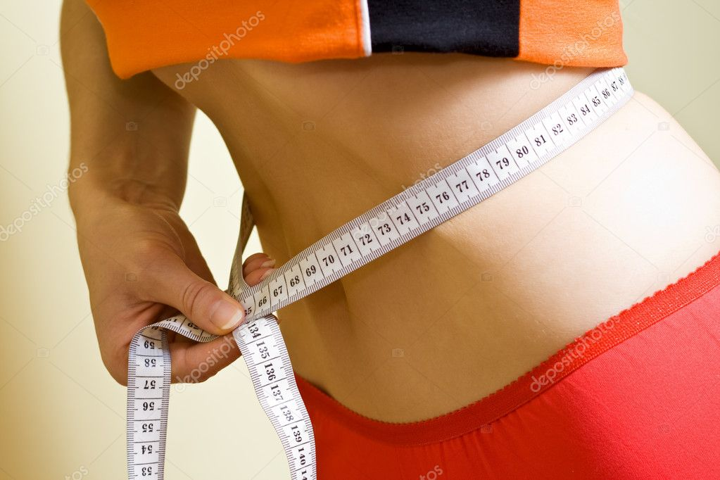 Woman measuring her sexy healthy waistline — Stock Photo #4942031