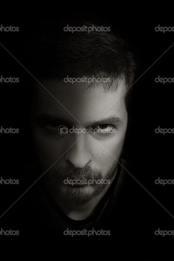 Low-key portrait of an ominous man emerging from the dark — Stock Photo #4942376