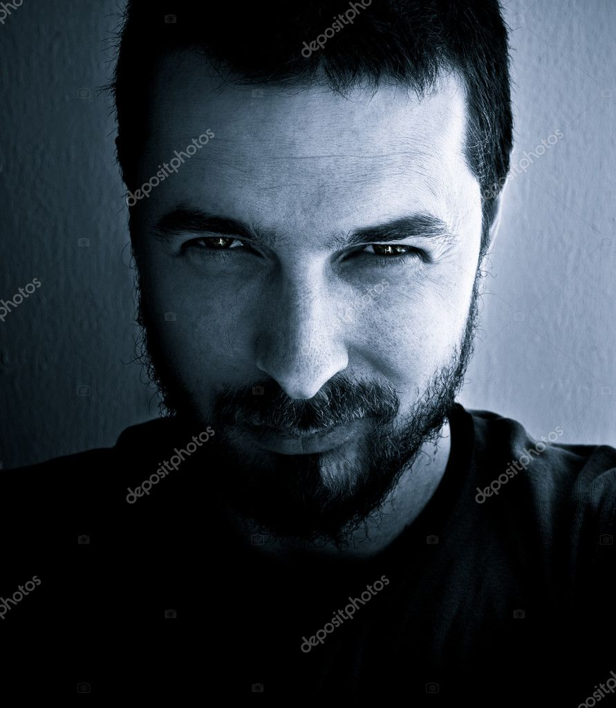 Portrait of dangerous and interesting looking man  Stock Photo #4942450