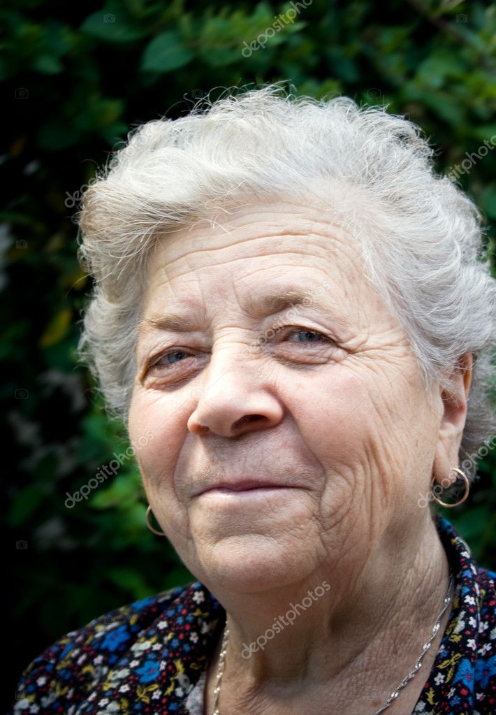 Portrait of smiling and happy senior lady — Stock Photo #4942466