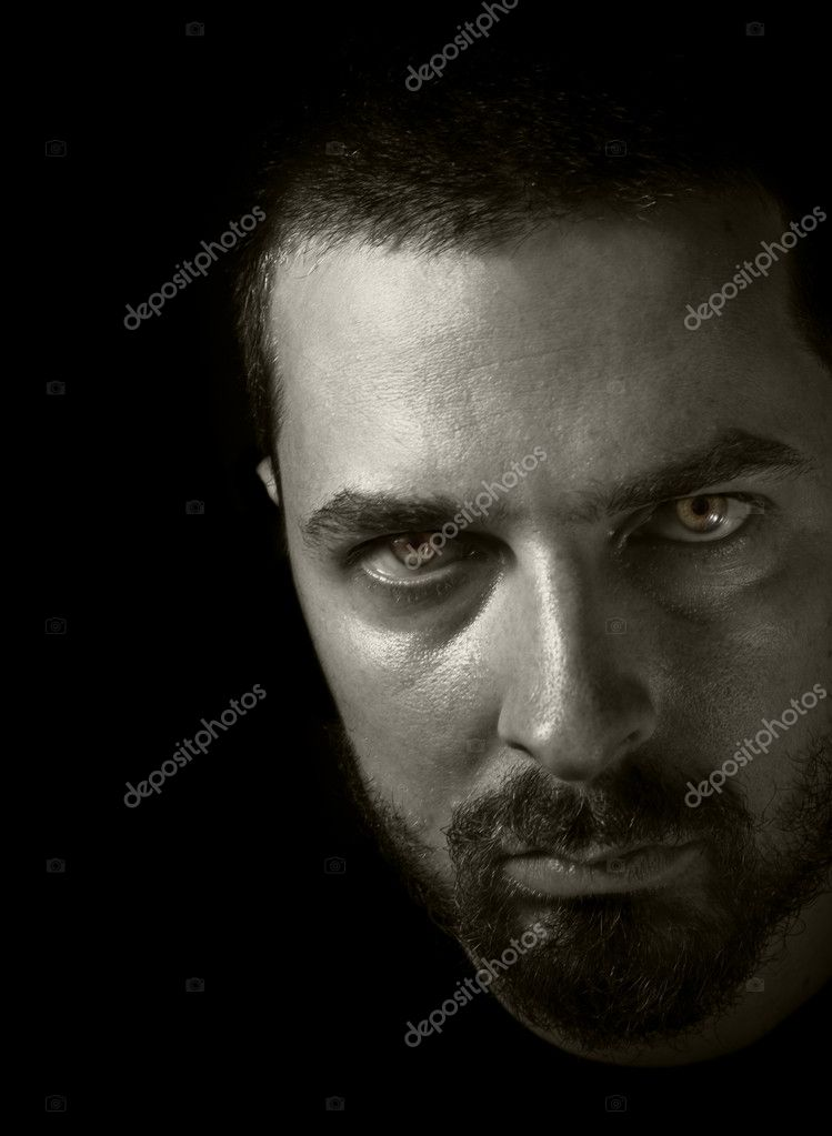 Low key portrait of man with evil eyes  Stock Photo #4942978
