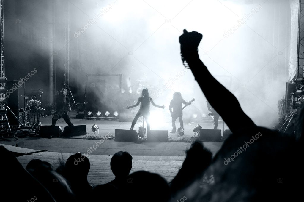 Scene from a rock concert with silhouette singer — Stock Photo #4943034