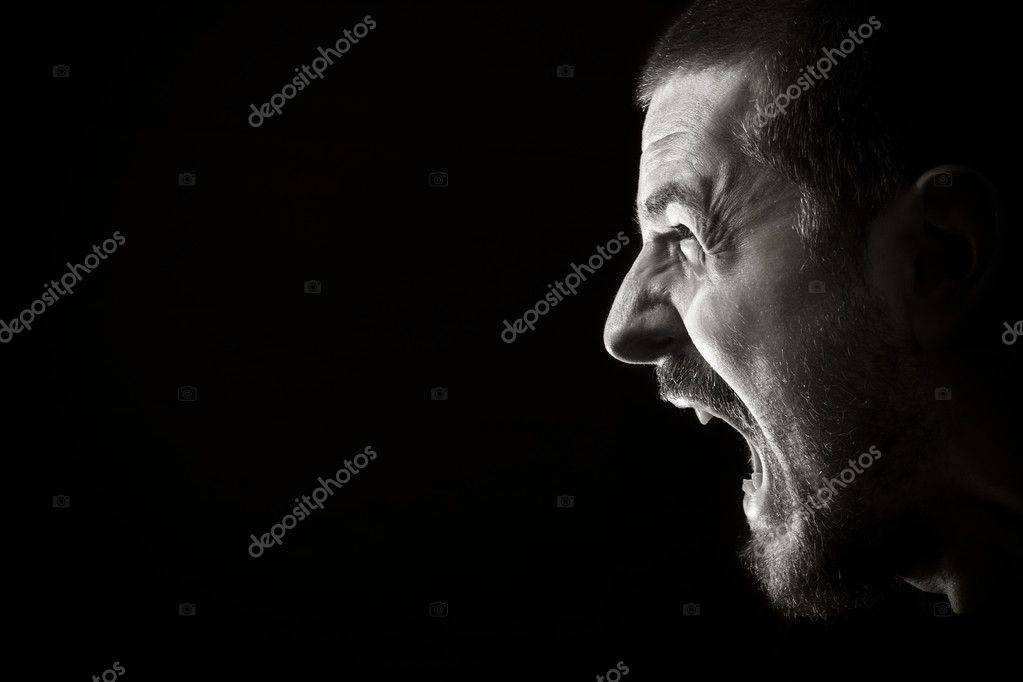 Portrait of screaming angry man on black background — Stock Photo #4943072