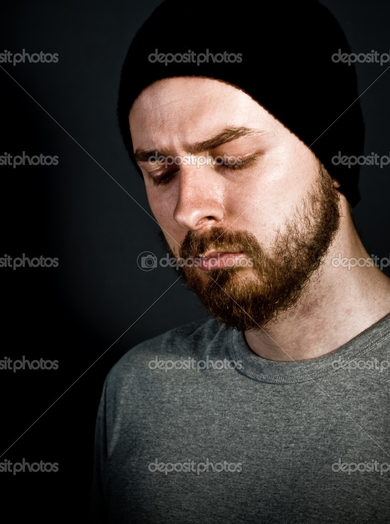 Low-key portrait of melancholic handsome man — Stock Photo #4943140